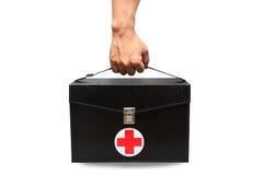 La boîte de kit de premiers secours à l'arrière-plan blanc ou au fond d'isolement, cas d'urgence a utilisé la boîte d'aide pour l Image libre de droits
