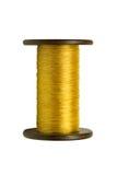La bobina de las cuerdas de rosca del oro Fotos de archivo