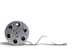 La bobine de film avec une bande 3d de film rendent sur le blanc Images libres de droits