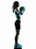 La bola de medicina de la aptitud de la mujer ejercita la silueta Imagen de archivo libre de regalías