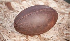 La bola miente en un fondo de madera Imagen de archivo libre de regalías