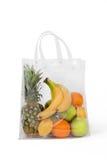 La bolsa de plástico con las frutas Foto de archivo libre de regalías
