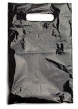 La bolsa de plástico negra Imágenes de archivo libres de regalías