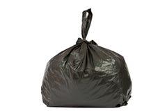 La bolsa de plástico negra con basura Fotografía de archivo libre de regalías
