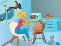 La bonne d'enfants dans la cuisine alimente l'enfant Photo libre de droits