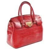 La borsa di cuoio femminile rossa fatta della pelle del rettile/ha isolato su bianco Immagini Stock