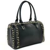 La borsa nera delle donne di bellezza con i perni dell'oro su bianco Immagini Stock Libere da Diritti