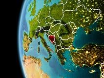 La Bosnia-Erzegovina da spazio nella sera Immagini Stock Libere da Diritti