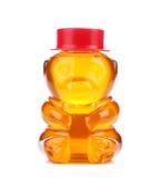 La botella formó como un oso y llenó de la miel. Imágenes de archivo libres de regalías