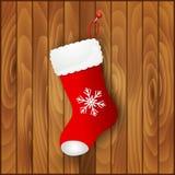La botte de Santa rouge sur le fond en bois illustration stock