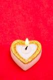 La bougie comme coeur est allumée Photo libre de droits