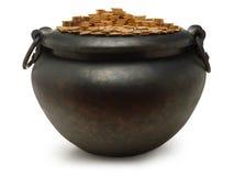La bouilloire de fer a rempli de l'or Image stock