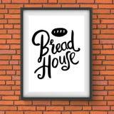 La boulangerie de Chambre de pain se connectent le mur de briques rouge Photographie stock libre de droits