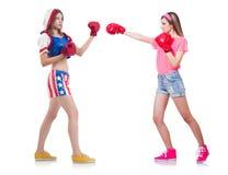 La boxe de deux femmes d'affaires d'isolement sur le blanc Photos stock