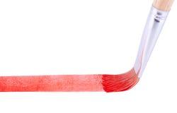 La brocha que dibuja la línea roja Imágenes de archivo libres de regalías