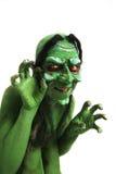 La bruja de mirada verde tiene gusto de la criatura Imagen de archivo libre de regalías