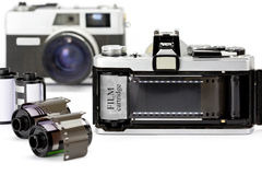 La cámara de 35m m con la película Fotografía de archivo