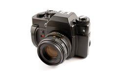 La cámara vieja de la película en un fondo blanco Fotografía de archivo libre de regalías