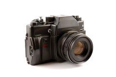 La cámara vieja de la película en un fondo blanco Imágenes de archivo libres de regalías