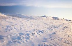 La côte neige-couverte photo libre de droits