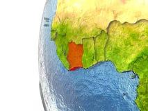 La Côte d'Ivoire sur le globe illustration stock