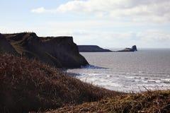 La cabeza del gusano según lo visto de la bahía de Rhossili, País de Gales Imagenes de archivo