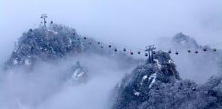 La cabina di funivia alle nubi Immagini Stock
