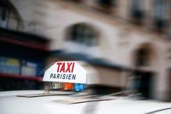 La cabine de signe de taxi jeûnent Photographie stock