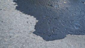 La caduta di olio può essere pericolosa E inquinamento ambientale di causa immagine stock libera da diritti