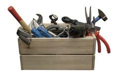 La caja de herramientas de madera en un fondo blanco imagen de archivo