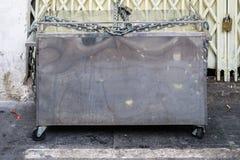 La caja del acero inoxidable en la acera Foto de archivo libre de regalías