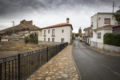 La Calahorra town and the ancient Castle-Palace on a cloudy day, Province of Granada, Spain Stock Images