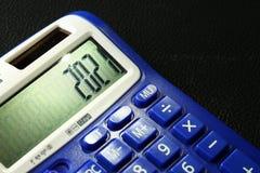 La calculadora azul vieja y sucia del color Foto de archivo