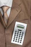La calculadora miente en el traje Imagen de archivo libre de regalías