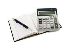 La calculadora un cuaderno Fotos de archivo