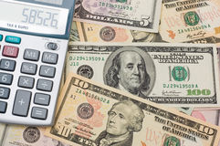 La calculatrice et dollars US Images libres de droits