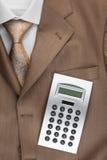 La calculatrice se trouve sur le costume Image libre de droits