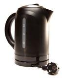 La caldera de té eléctrica plástica negra imagenes de archivo