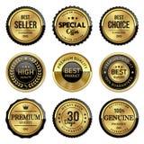 La calidad superior del oro de las etiquetas fijó en el fondo blanco Imagen de archivo
