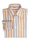 La camicia degli uomini a strisce piegati Immagini Stock