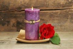 La candela ed il colore rosso sono aumentato Immagine Stock Libera da Diritti