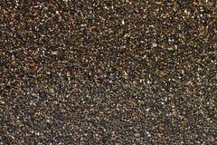 La capa mojada de pequeños guijarros Foto de archivo libre de regalías