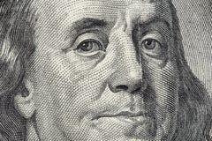 La cara de Benjamin Franklin en el billete de dólar de los E.E.U.U. 100 Fotos de archivo libres de regalías