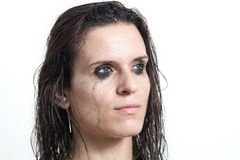 La cara de la mujer con la tinta comenzada del flujo Fotografía de archivo libre de regalías