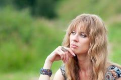 La cara de la mujer de pensamiento Fotos de archivo libres de regalías
