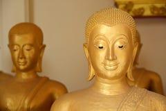 La cara de oro de buddha Fotografía de archivo libre de regalías
