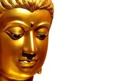 La cara de oro de la estatua vieja de Buda aislada con el spac de la copia Imagen de archivo