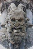 La cara del demonio de la gárgola centró ruinas de la escultura foto de archivo libre de regalías