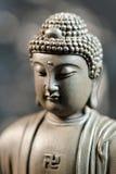 La cara del zen del Buda-estilo en fondo natural Foto de archivo libre de regalías