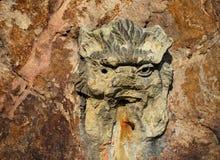 La cara talló en la roca Fotografía de archivo